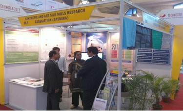 Mrs. Manisha A. Hira, Scientist 'C', SASMIRA Interacting with Visitors at Technotex-2013.