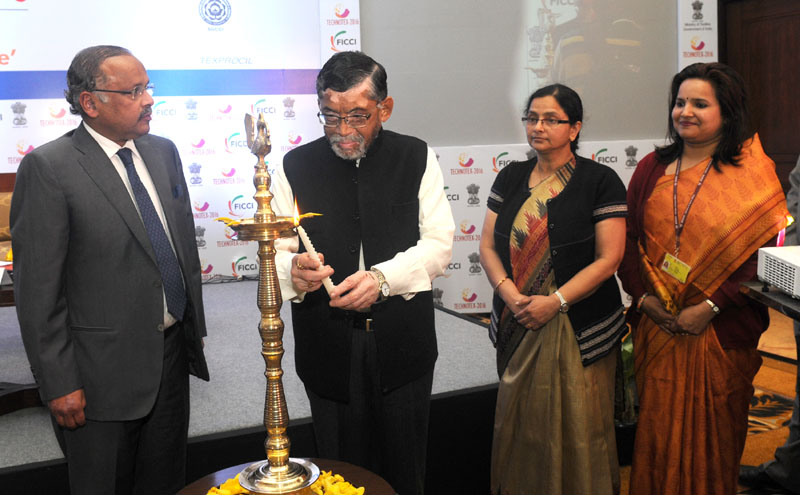 """The Minister of State for Textiles (Independent Charge), Shri Santosh Kumar Gangwar lighting the lamp at the Curtain Raiser event of Technotex 2016 """"Technical Textiles – Towards a Smart Future"""", in New Delhi on January 29, 2016."""