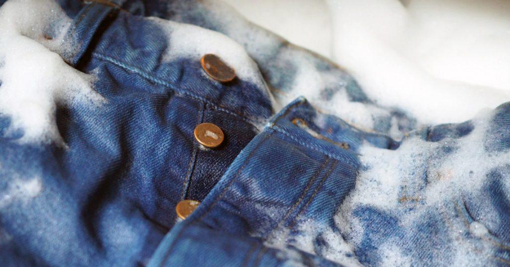 single bath desizing and stone washing of jeans and denim garments