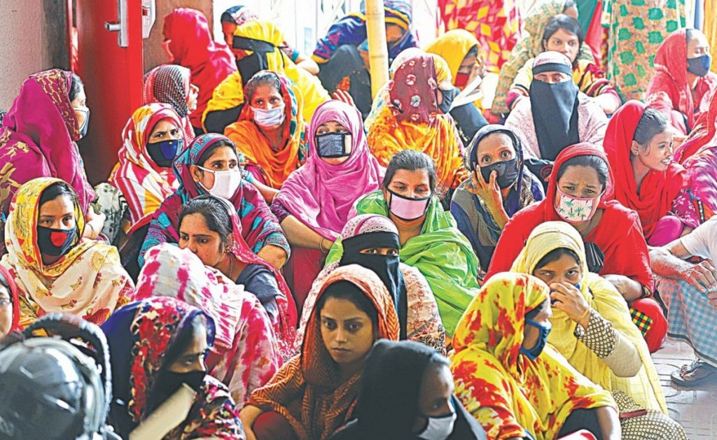 Garment workers who have not been paid for months gather to demonstrate in front of their factory at Malibagh in the capital in April